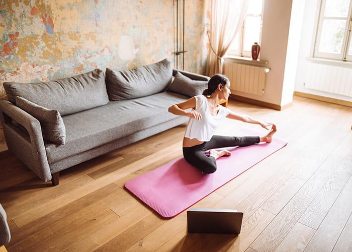 woman-doing-yoga-at-home-1130167716_700x500-min